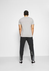 adidas Performance - BOSC - Tracksuit bottoms - black - 2