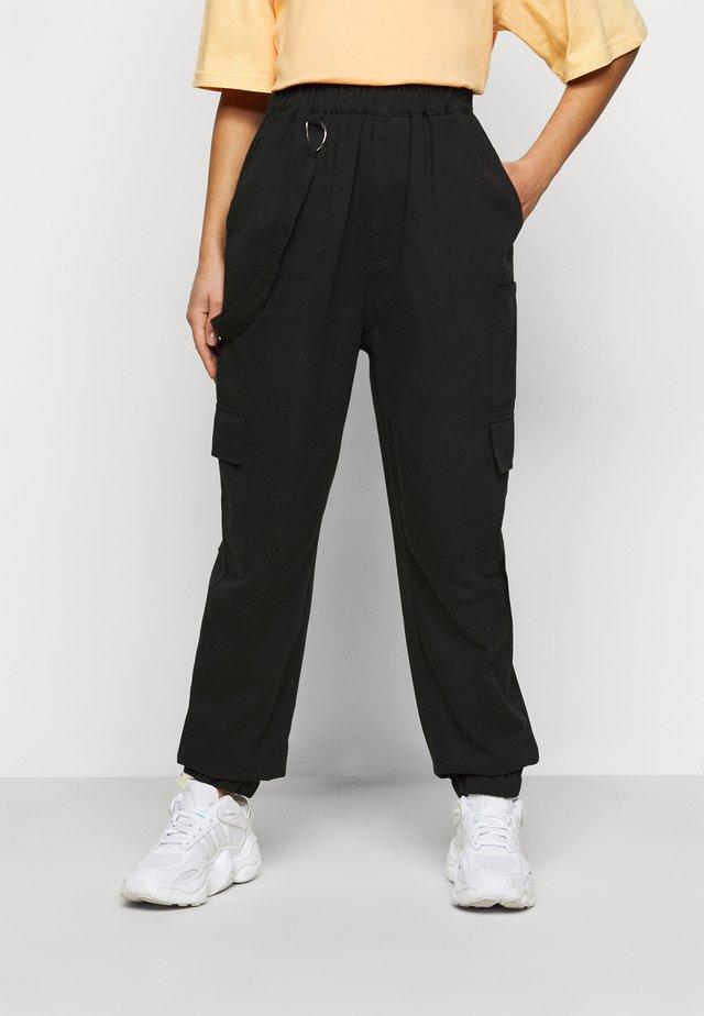 RING STRAP PANT - Reisitaskuhousut - black