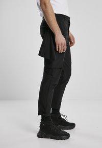Urban Classics - Cargo trousers - black - 4