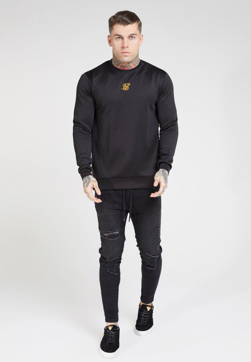 SIKSILK - SIDE ZIP CREW - Long sleeved top - black
