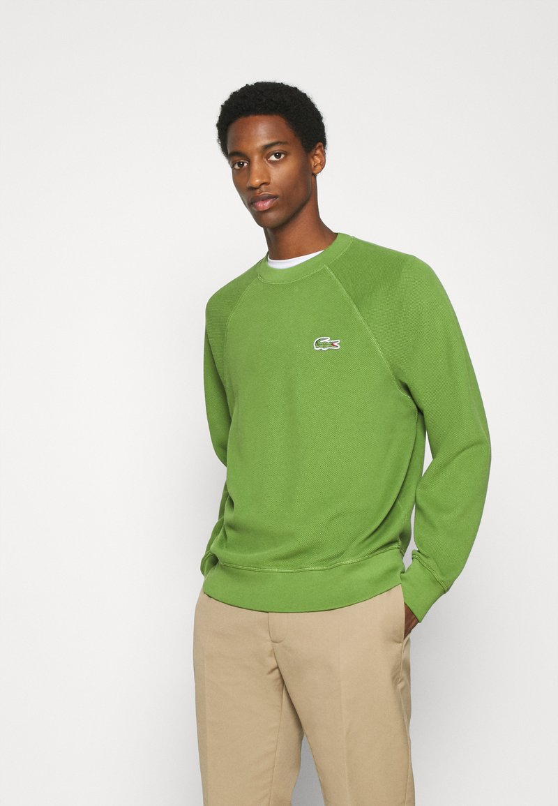 Lacoste - Collegepaita - tax