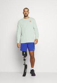 Nike Performance - DRY TEE TRAIL - Camiseta de deporte - pistachio frost - 3
