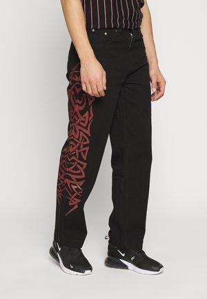 TRIBAL SCREEN PRINT SKATE - Jeans baggy - black