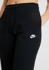 Nike Sportswear - Tracksuit bottoms - black/white - 4