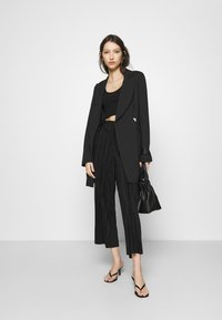 Monki - SEVERINA TROUSERS - Trousers - black dark - 1