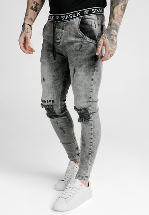 DISTRESSED - Vaqueros pitillo - snow wash