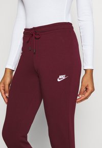 Nike Sportswear - Tracksuit bottoms - dark beetroot/white - 4