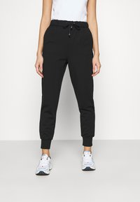 ONLY - ONLPOPTRASH EASY RELAX PANT - Tracksuit bottoms - black - 0