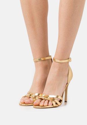 BRINKLEY ANKLE STRAP - Sandaalit nilkkaremmillä - gold