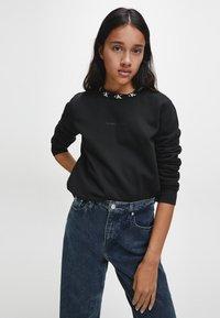 Calvin Klein Jeans - Sweatshirt - ck black - 0
