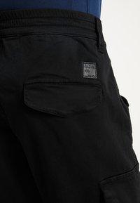 Alpha Industries - AIRMAN - Cargo trousers - black - 5