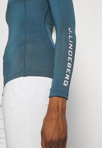 J.LINDEBERG - ÅSA SOFT COMPRESSION - Long sleeved top - orion blue - 5