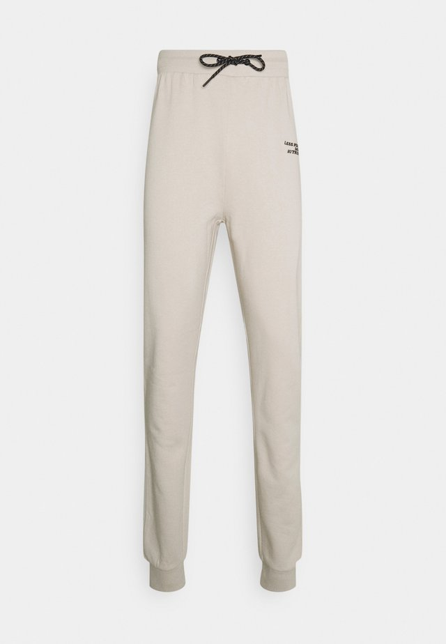 UNISEX  - Tracksuit bottoms - dove