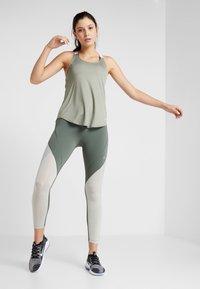 Nike Performance - DRY TANK ELASTIKA - Sports shirt - jade stone/white - 1