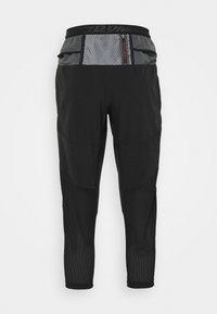 Nike Performance - 7/8 PANT - Træningsbukser - black - 1