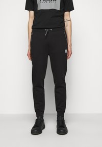 HUGO - DOX  - Tracksuit bottoms - black - 0
