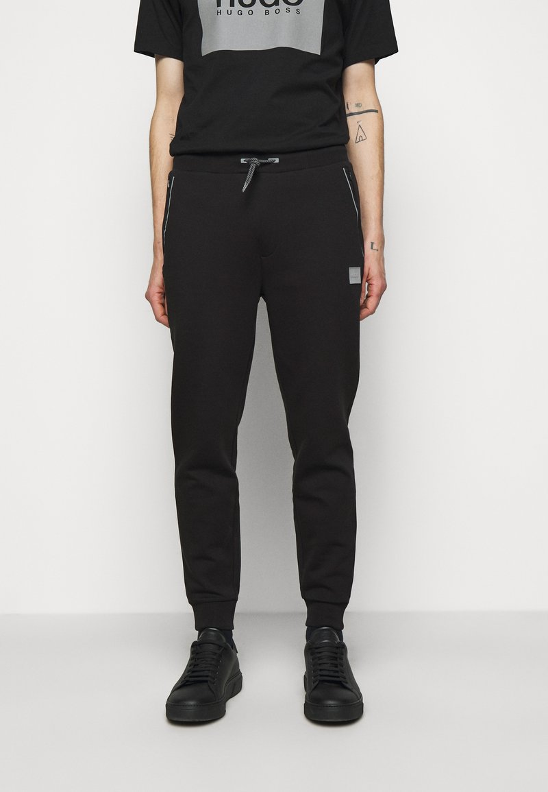 HUGO - DOX  - Tracksuit bottoms - black