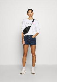 Calvin Klein Jeans - Denim shorts - dark blue stone shank - 1