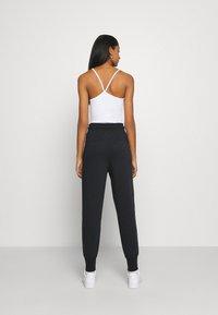 Nike Sportswear - Jogginghose - black/black - 2