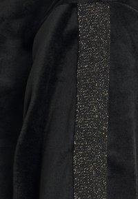 Hunkemöller - TOP SHIMMER TAPE - Noční košile - black - 2