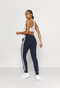 adidas Performance - ESSENTIALS FRENCH TERRY STRIPES PANTS - Tracksuit bottoms - legend ink/white - 2