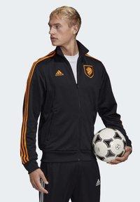 adidas Performance - NIEDERLANDE TRK JKT - Training jacket - black - 3