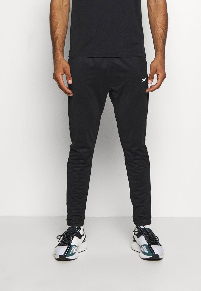 Reebok - PANT - Teplákové kalhoty - black