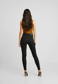 Gina Tricot - HIGHWAIST - Jeans Skinny Fit - off black - 2