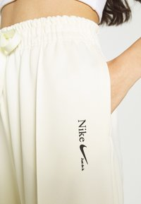 Nike Sportswear - TREND PANT - Tracksuit bottoms - coconut milk - 4