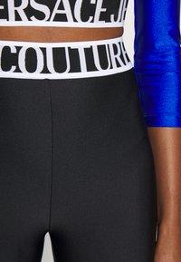 Versace Jeans Couture - PANTS - Leggings - Trousers - black - 8