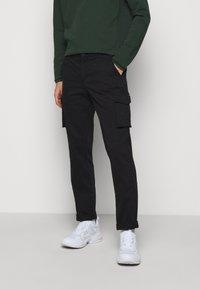 forét - DUST CARGO  - Cargo trousers - black - 0