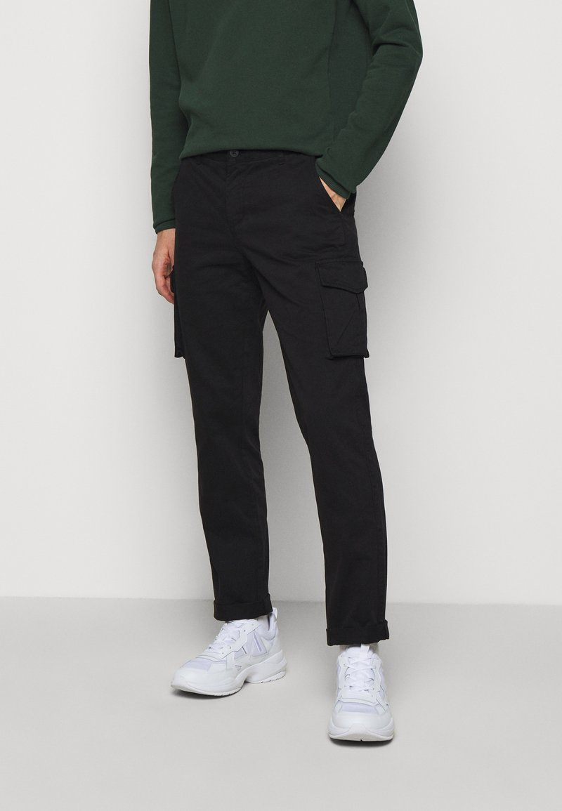 forét - DUST CARGO  - Cargo trousers - black