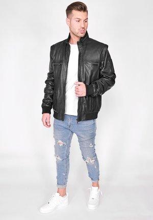 MIT ABNEHMBAREN ÄRMELN - Leather jacket - black