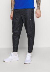 Nike Performance - SHIELD - Trainingsbroek - black/reflective silver - 0
