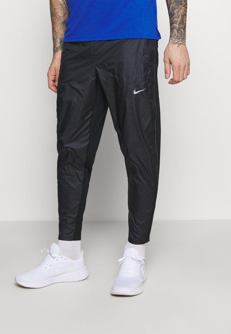 Nike Performance - SHIELD - Tracksuit bottoms - black/reflective silver