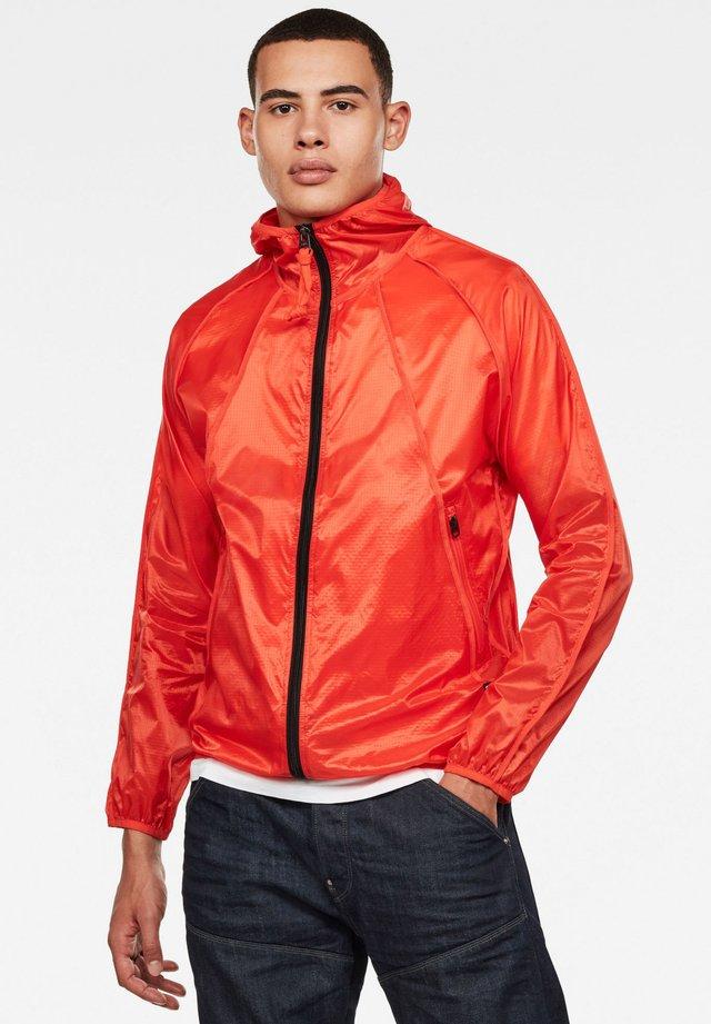 OZONE - Waterproof jacket - bright acid