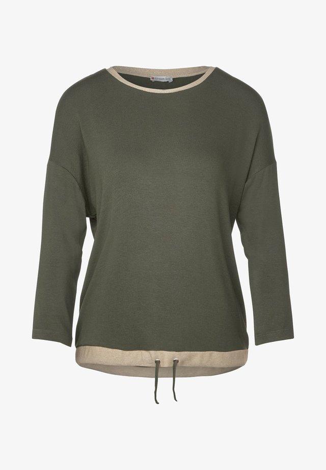 MIT GLITZER-DETAILS - T-shirt à manches longues - grün