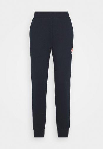 QUEENSTOWN - Tracksuit bottoms - dark blue