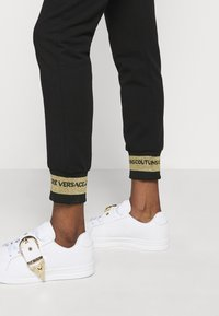 Versace Jeans Couture - Tracksuit bottoms - black/gold - 3
