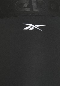 Reebok - CAPRI - 3/4 sports trousers - night black - 2