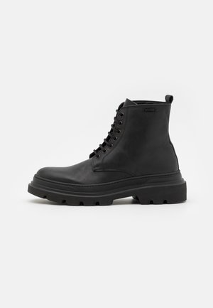 LACE UP BOOT 3D LOGO METAL PLATE - Lace-up ankle boots - black