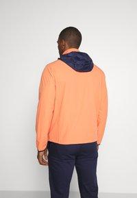 Polo Ralph Lauren Golf - HOOD ANORAK JACKET - Waterproof jacket - true orange - 2