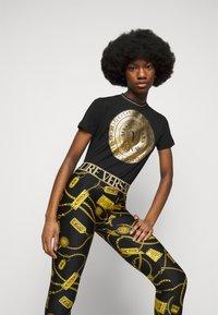 Versace Jeans Couture - Leggings - Trousers - black - 4