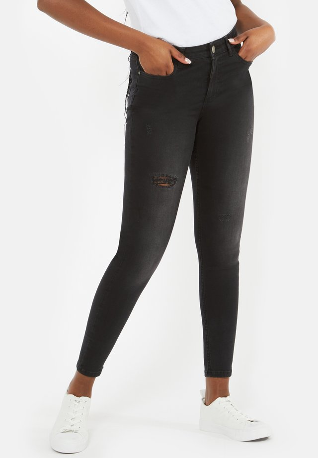 MULTIPLE RIP - Jeans Skinny Fit - blackdenim