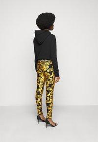 Versace Jeans Couture - LADY FUSEAUX - Legging - black - 2