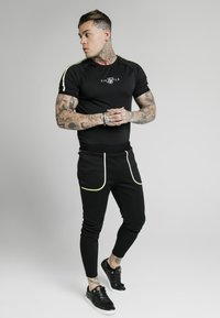 SIKSILK - LEGACY FADE TRACK PANTS - Tracksuit bottoms - black - 1