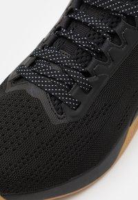 Reebok - NANO X1 - Sports shoes - black/night black - 5