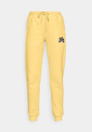 VARSITY JOGGER - Spodnie treningowe - beige