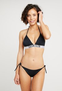 Calvin Klein Swimwear - INTENSE POWER CHEEKY STRING SIDE TIE - Bikini bottoms - black - 1