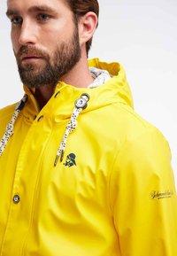 Schmuddelwedda - ANORAK - Waterproof jacket - yellow - 3